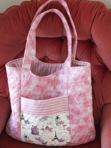 Pink quilted hand bag