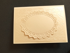 Die cut adhered onto the card
