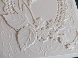 Rose petals adhered to the base of the card above the other die cuts