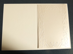 Trimmed embossed card on the base card