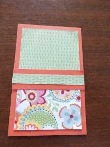 Adhere the patterned piece into the centre of the coloured cardstock and then pl