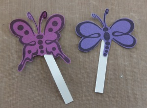 Butterflies on long pieces of card