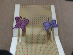 the butterflies being glued onto the fold