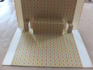 The front of the inner with all the folds and the patterned paper strip
