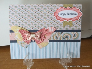 CTMH Ariana card made using the Artbooking cartridge to cut the butterfly and the Holidays Tag stamp set using the Art Philosophy cartridge.  I have used Sorbet ink and Outdoor Denim for the sentiment.  Finished with a ribbon bow from the Ariana assortments.